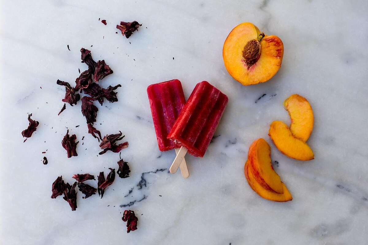 Leena Trivedi-Grenier's peach hibiscus popsicle, which incorporates a blended peach with skin photographed at her home in Oakland, California on July 10, 2020.