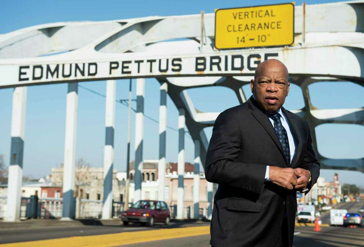 """UNITED STATES - FEBRUARY 14: Rep. John Lewis, D-Ga., stands on the Edmund Pettus Bridge in Selma, Ala., in between television interviews on Feb. 14, 2015. Rep. Lewis was beaten by police on the bridge on """"Bloody Sunday"""" 50 years ago on March 7, 1965, during an attempted march for voting rights from Selma to Montgomery. (Photo By Bill Clark/CQ Roll Call)"""