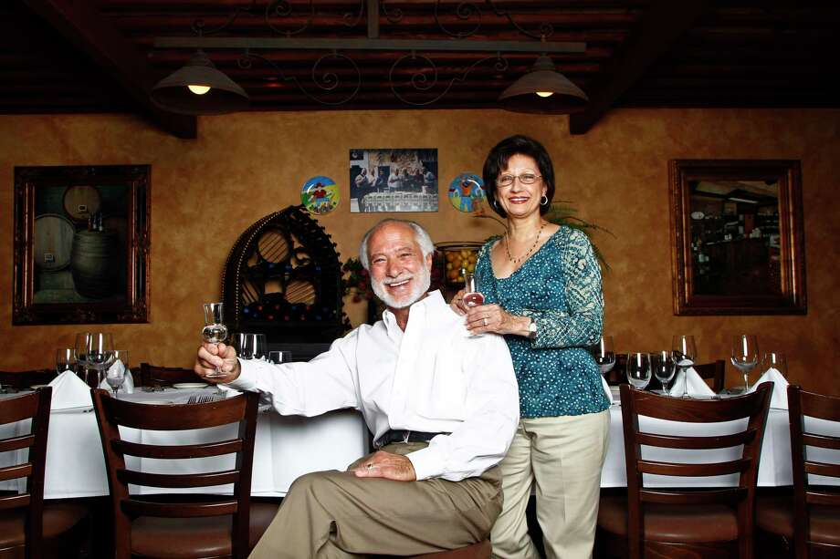 Vincent Mandola and his wife Mary, sit inside their restaurant, Grappino di Nino, which is one of only a few bars in Houston that serves Grappa, a strong Italian brandy, Tuesday, Sept. 14, 2010, in Houston. Photo: Michael Paulsen, Chronicle / Houston Chronicle