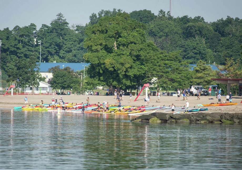 On Saturday morning, SoundWaters held its annual flotilla to raise awareness and educate about the Long Island Sound. Kayakers, standup paddleboards and others paddled from Darien and Stamford beaches. Photo: Bryan Haeffele /Hearst Connecticut Media /