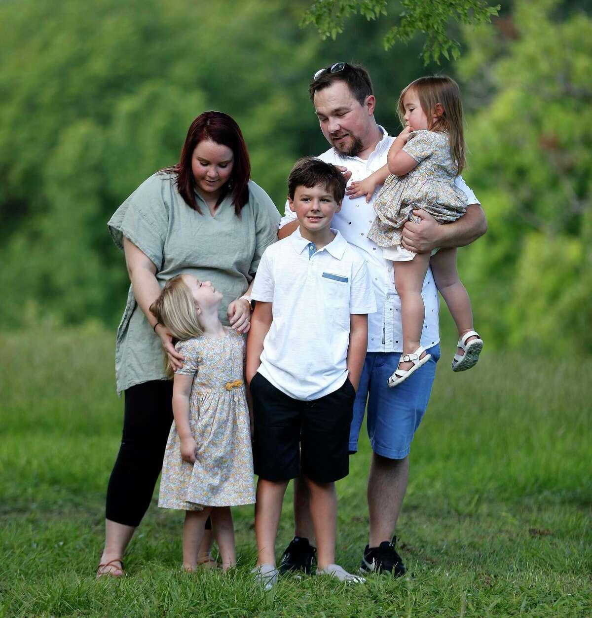 Stephanie Eldridge, with her husband, Joshua, and kids Emma, 2, Madeleine, 4, and Owen, 9, at Spotts Park, Saturday, July 18, 2020, in Houston.