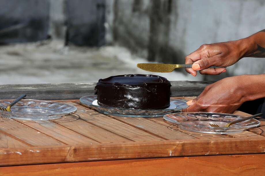 Indira Allegra, 40, conceptualizes a memorial for all of us in this moment -- to recognize those lost by COVID-19 and police brutality. In this prompt, bake a birthday cake for someone who died this year. Plate two slices. Eat yours. Photo: Yalonda M. James, The Chronicle