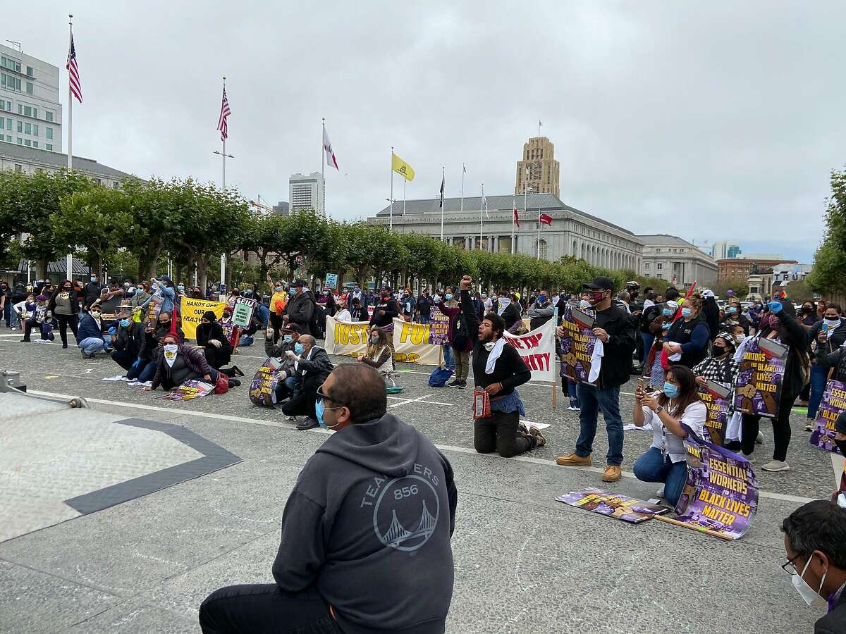 Labor union members gathered in front of San Francisco City Hall on Monday, call for racial justice and labor rights.