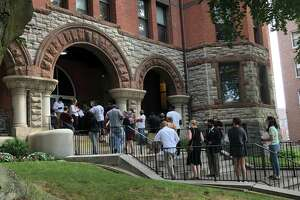 Hopeful citizens line up to get into the Golden Hill courthouse for the first time in four months after the doors shut during the early days of the pandemic.