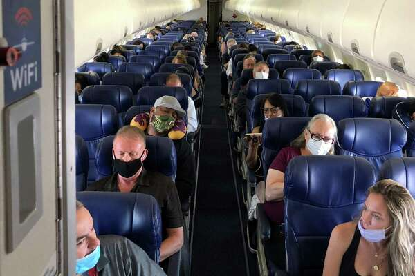 Masked passengers fill a Southwest Airlines flight from Burbank, Calif., to Las Vegas on June 3. Now carriers are finally getting tough, banning passengers who refuse to put on masks - even though the airlines desperately need the revenue to stay in business.