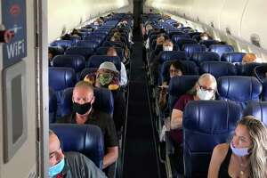 Masked passengers fill a Southwest Airlines flight from Burbank, Calif., to Las Vegas on June 3. Now carriers are finally getting tough, banning passengers who refuse to put on masks — even though the airlines desperately need the revenue to stay in business.