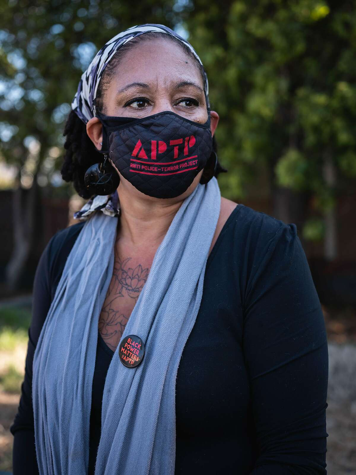 Friday, June 17, 2020, Community activist, Cat Brooks, looks outward from McClymonds park in her West Oakland neighborhood. Brooks has been a strong voice in the Black Lives Matter movement as well as leading the charge for the defunding of the Oakland Police Department. OAKLAND, CA.