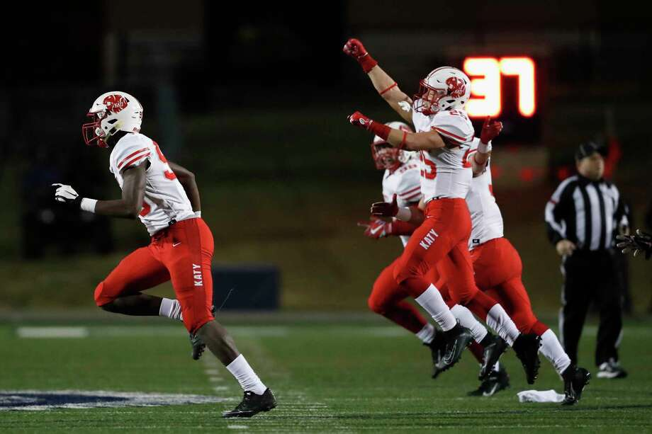 Katy Tigers defensive end Malick Sylla (93) and Shepherd Bowling (25) celebrate after a fumble recovery during the second half of the high school football playoff game between the Katy Tigers and the Cy-Fair Bobcats at Tully Stadium in Houston, TX on Friday, November 22, 2019. The Tigers defeated the Bobcats 27-14. Photo: Tim Warner, Houston Chronicle / Contributor / ©Houston Chronicle