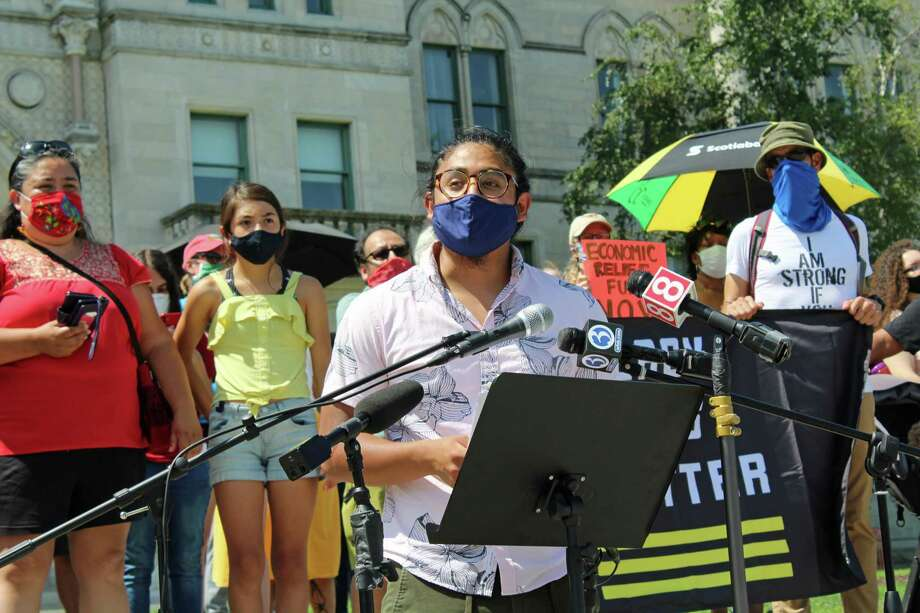 Eric Cruz Lopez, of CT Students for a Dream, speaks at a July 20, 2020 rally at the Connecticut State Capitol, in Hartford, Conn., demanding increased aid for immigrants, among other things. Photo: Justin Papp