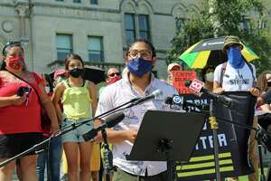 Eric Cruz Lopez, of CT Students for a Dream, speaks at a July 20, 2020 rally at the Connecticut State Capitol, in Hartford, Conn., demanding increased aid for immigrants, among other things.