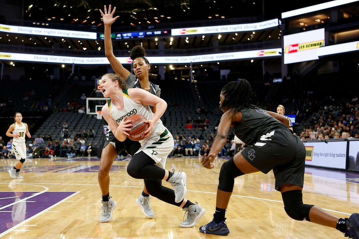 Pinewood Panthers Klara Astrom (11) drives as she's defended by the Sierra Canyon Trailblazers in the second half of the CIF State Girls Basketball Championships Open Division game at Golden 1 Center on Saturday, March 9, 2019, in Sacramento, Calif. Sierra Canyon Trailblazers won 69-51.