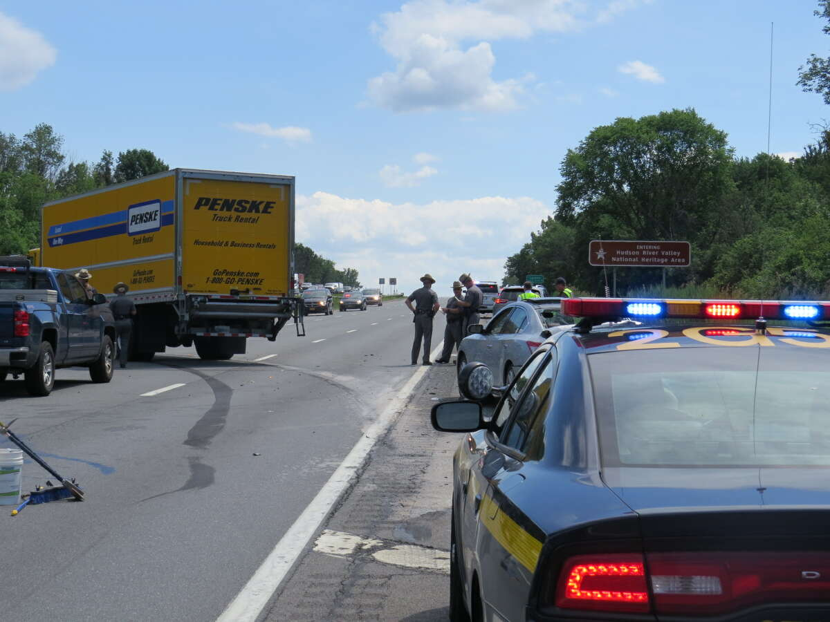 A state trooper was injured Monday afternoon after a Penske moving truck struck the patrol vehicle and a car that had been pulled over.