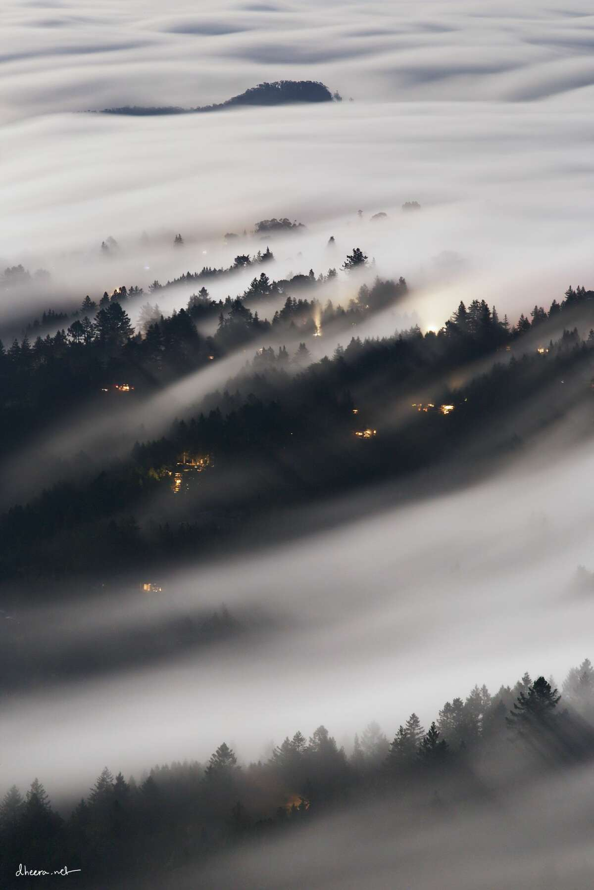 The Marin County hills near Mount Tamalpais are wrapped in fog in this photo by Palo Alto robotics engineer Dheera Venkatraman, whose work can be seen on Instagram.(Special to SFGATE.)