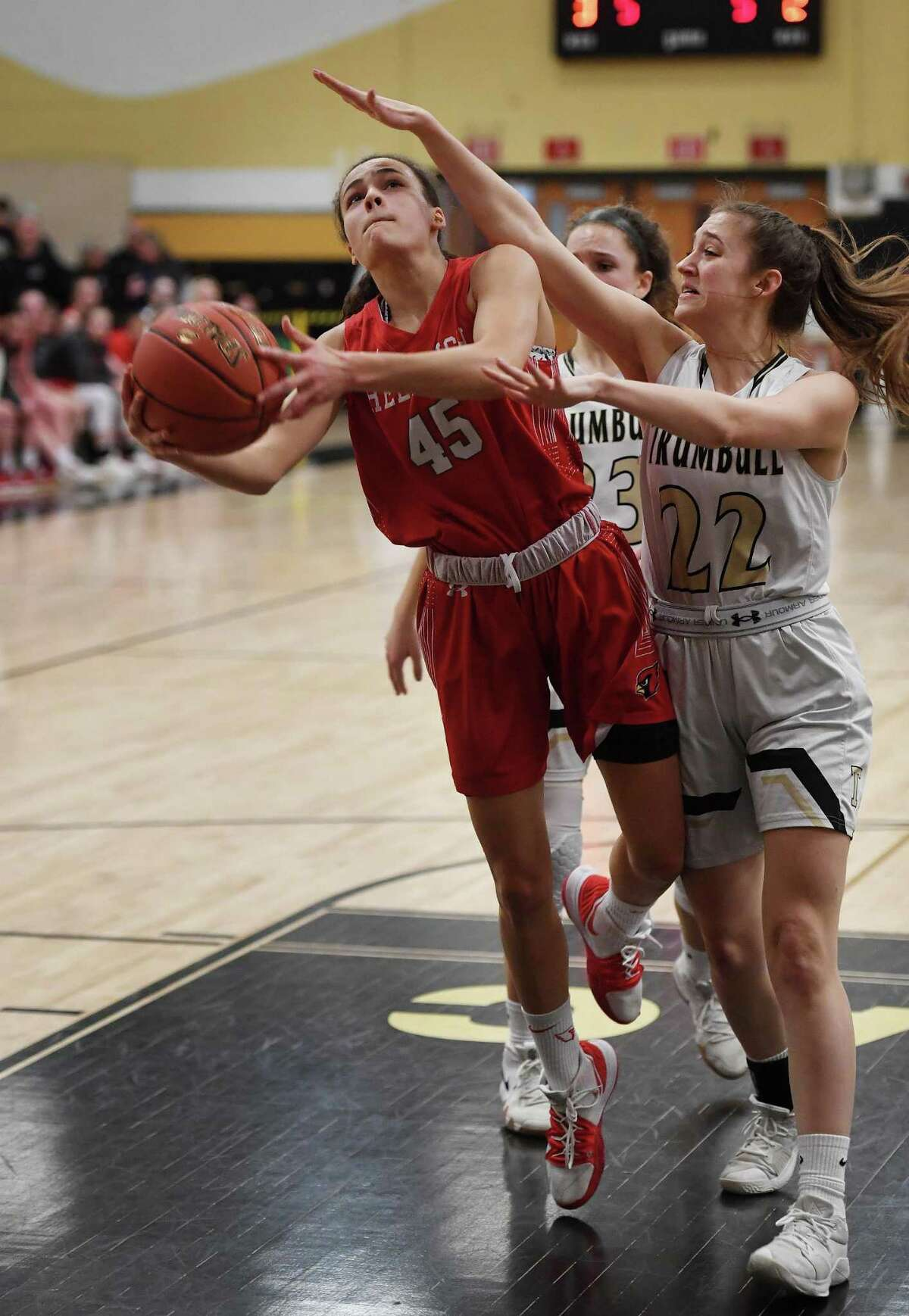 Greenwich's Mackenzie Nelson drives to the basket defended by Trumbull's Julia Lindwell during the first half of their CIAC Class LL girls basketball quarterfinal game at Trumbull High School in Trumbull, Conn. on Monday, March 9, 2020.