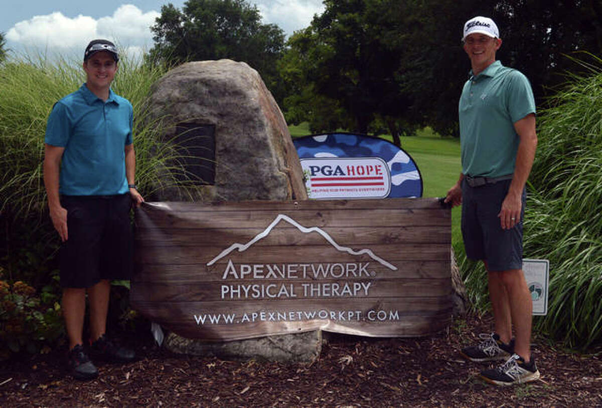 Cory Henry of Maryville, left, and Rob Blumberg of Edwardsville, both representing Apex Physical Therapy, were among the golfers taking part in the 100 Holes for Heroes Golf Marathon at Sunset Hills Country Club. The fundraising event supported PGA Hope and the Arlington Greens Veterans Golf Association.