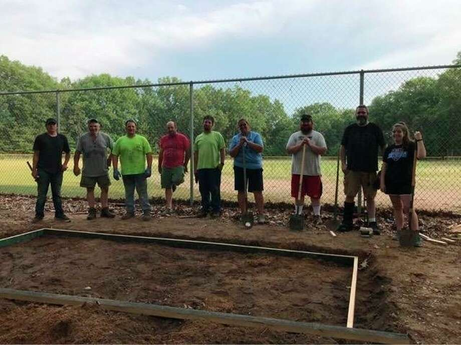 Volunteers got together in the Dickson Township Park to prep the area for new bleachers for the baseball field. (Courtesy photo)