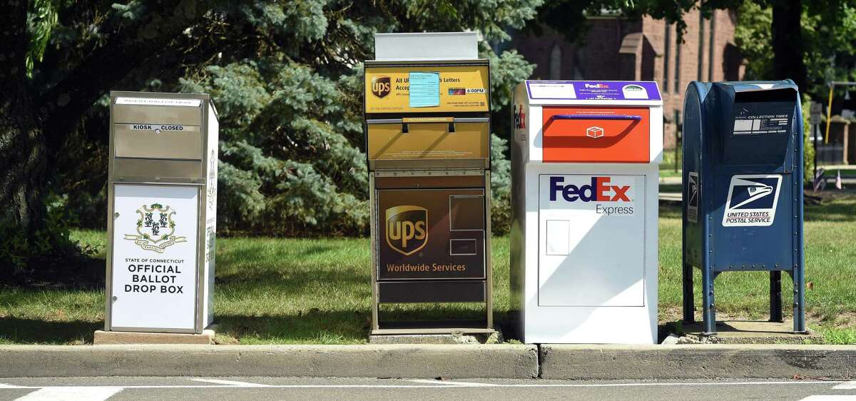 A Connecticut Official Ballot Drop Box that was installed across from Milford City Hall next to FedEx, UPS and USPS boxes is photographed on July 20, 2020. Kyle Rodrigues, Middletown