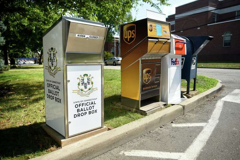 A Connecticut Official Ballot Drop Box that was installed across from Milford City Hall next to FedEx, UPS and USPS boxes is photographed on July 20, 2020. Photo: Arnold Gold / Hearst Connecticut Media / New Haven Register