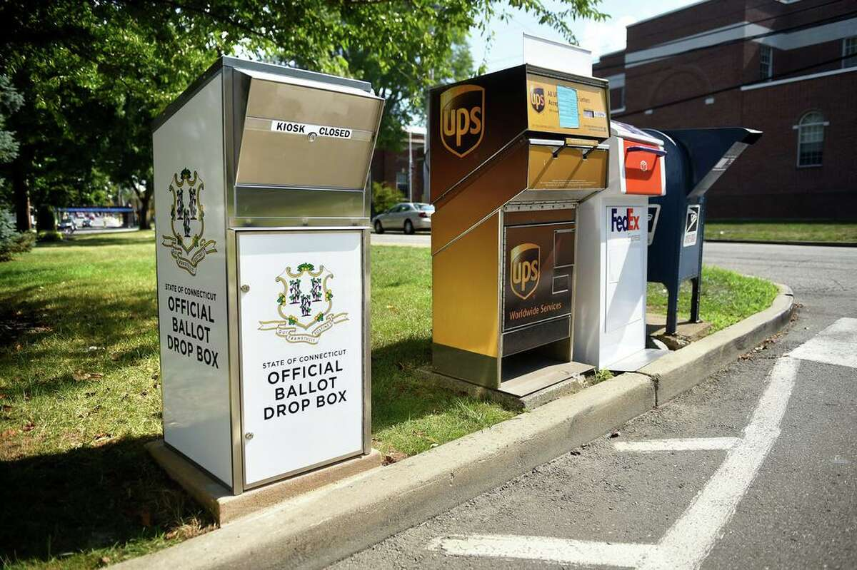 A Connecticut Official Ballot Drop Box that was installed across from Milford City Hall next to FedEx, UPS and USPS boxes is photographed on July 20, 2020.