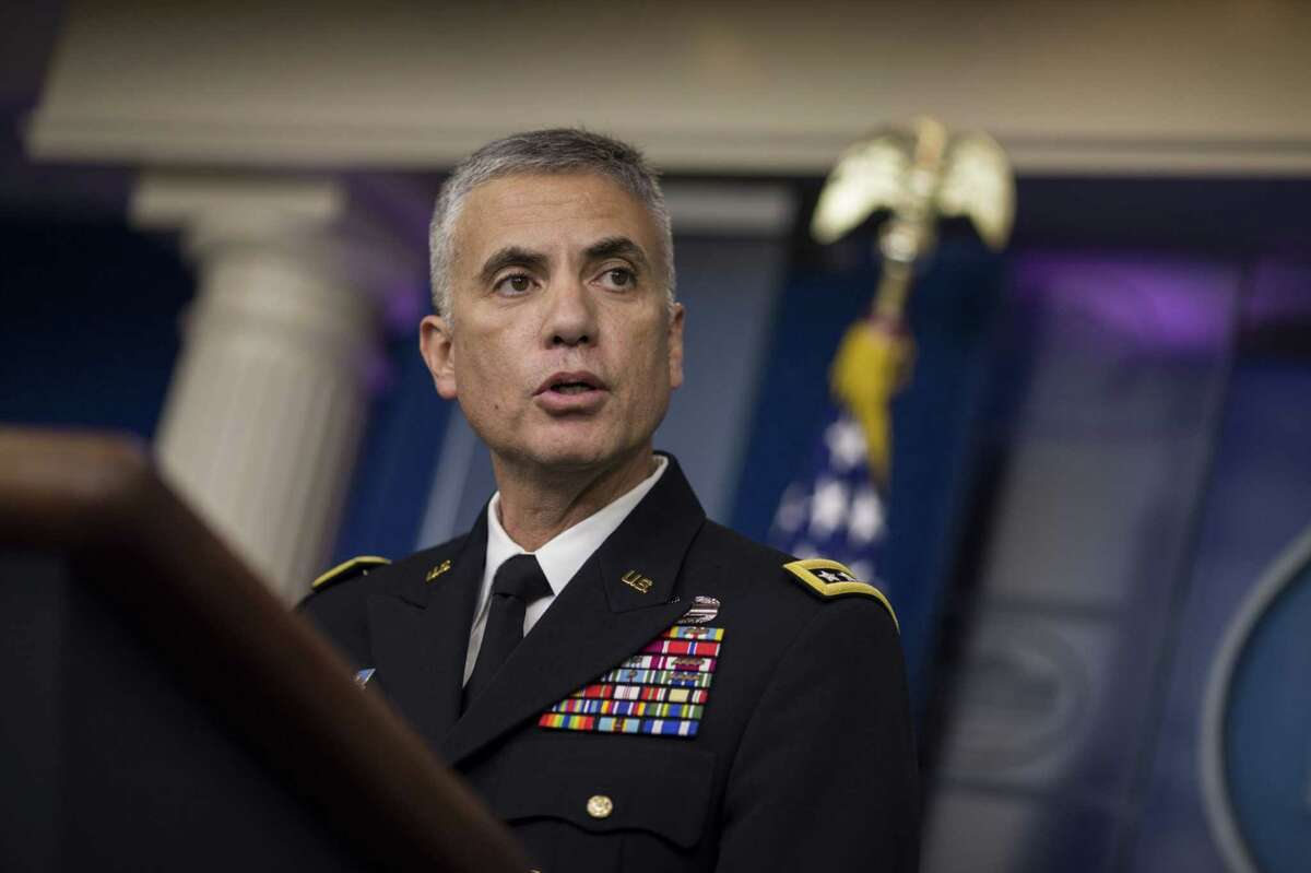 Paul Nakasone, director of the National Security Agency and commander of the U.S. Cyber Command, speaks during a White House briefing in 2018.