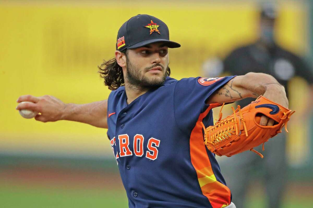 Houston Astros starting pitcher Lance McCullers Jr. throws during the first inning of an exhibition baseball game against the Kansas City Royals in Kansas City, Mo., Monday, July 20, 2020. (AP Photo/Charlie Riedel)