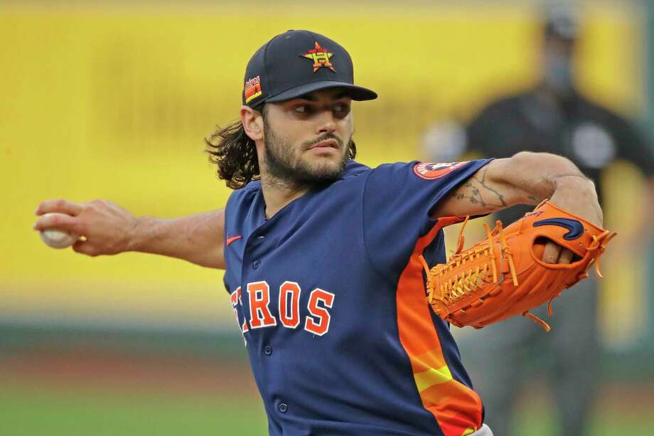 PHOTOS: A look at the Astros' workout Wednesday in Minute Maid Park Houston Astros starting pitcher Lance McCullers Jr. throws during the first inning of an exhibition baseball game against the Kansas City Royals in Kansas City, Mo., Monday, July 20, 2020. (AP Photo/Charlie Riedel) Photo: Charlie Riedel, Associated Press / Copyright 2020 The Associated Press. All rights reserved.