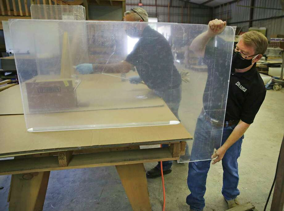 Owner James Franks, right, has added plexiglass shields to Franks Manufacturing's product line. Franks says the company makes 600 shields per day. Photo: Bob Owen /Staff Photographer / ©2020 San Antonio Express-News