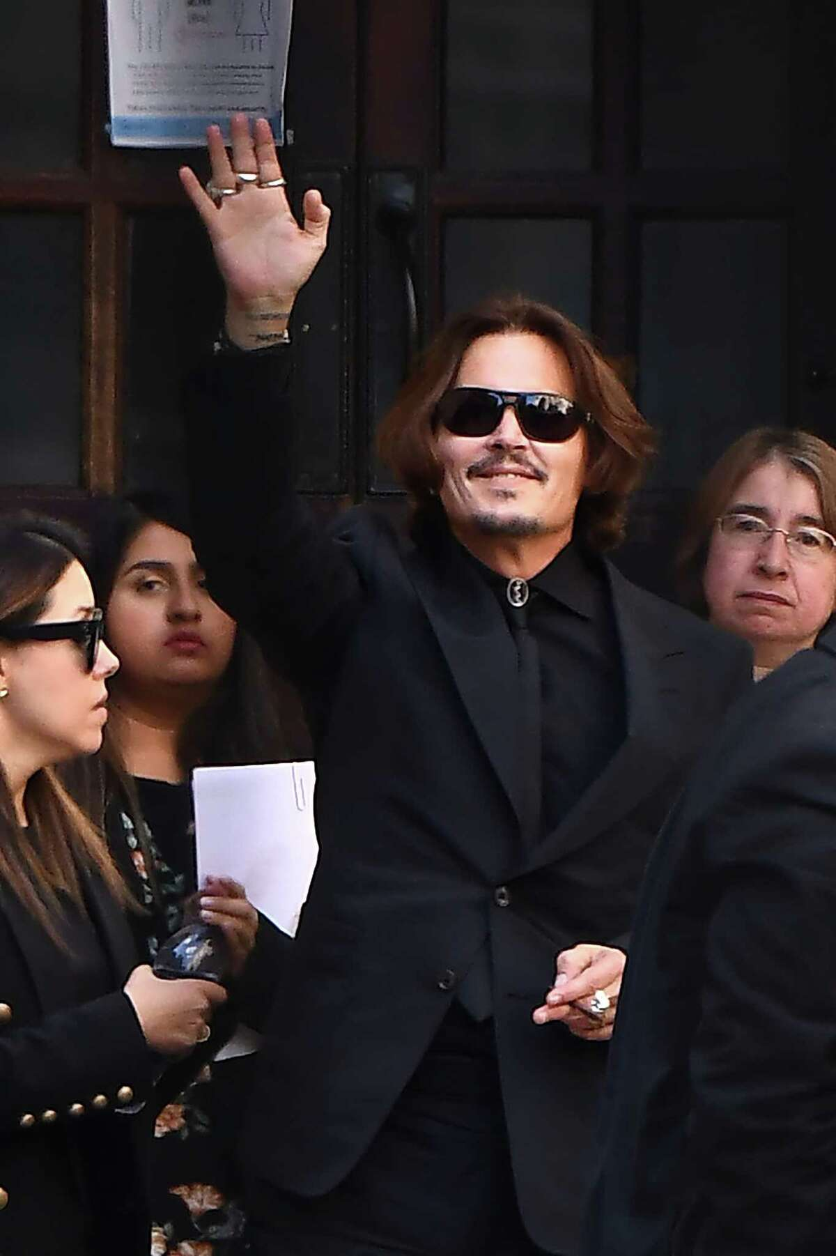 LONDON, ENGLAND - JULY 20: Actor Johnny Depp waves as he departs Royal Courts of Justice, Strand on July 20, 2020 in London, England. The Hollywood Actor is suing News Group Newspapers (NGN) and the Sun's executive editor, Dan Wootton, over an article published in 2018 that referred to him as a