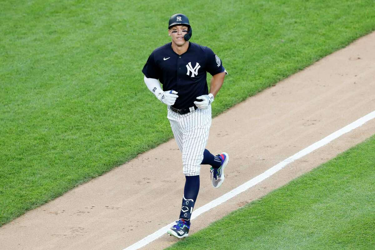 New York Yankees' Aaron Judge runs the bases after hitting a solo home run during the fifth inning of an exhibition baseball game against the Philadelphia Phillies, Monday, July 20, 2020, at Yankee Stadium in New York. (AP Photo/Kathy Willens)