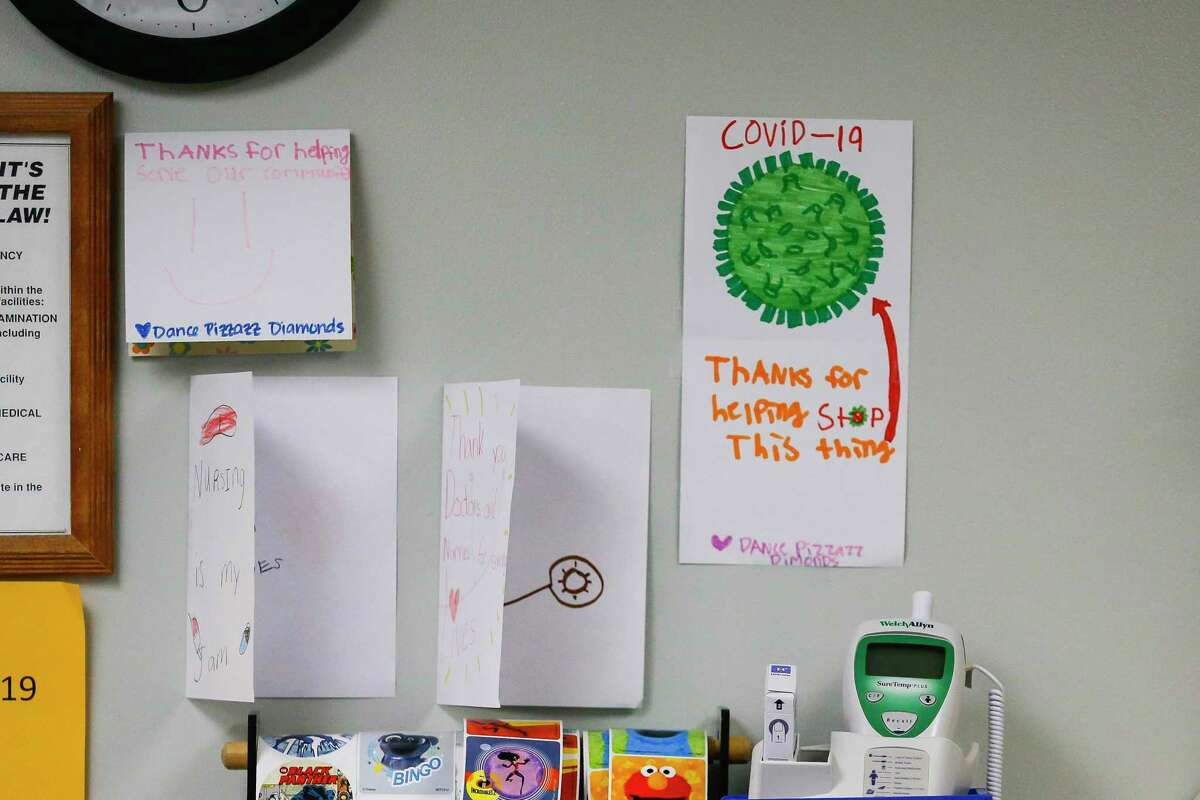Cards from a local dance team thanking health care workers hang on the emergency room wall behind the nurses station, Monday, July 20, 2020, at El Campo Memorial Hospital in El Campo, TX. The small, rural hospital has created an isolated hallway for COVID patients as well as accepting COVID patients in their four ICU beds.