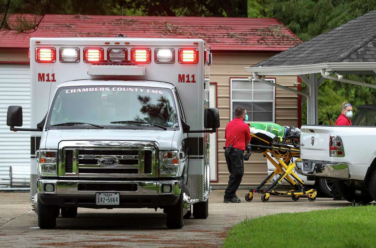 Courtney Whitney, right, an EMT with Chambers County EMS, and John Hulsey, a paramedic, arrive at a call Monday, July 20, 2020, in Anahuac.
