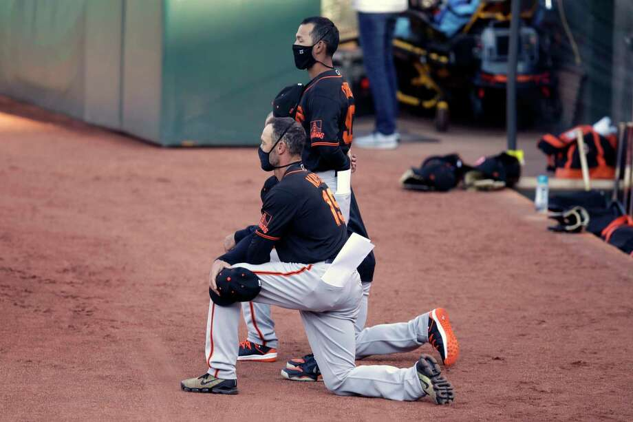 San Francisco Giants' manager Gabe Kapler kneels during the national anthem prior to an exhibition baseball game against the Oakland Athletics, Monday, July 20, 2020, in Oakland, Calif. Photo: Ben Margot, AP / Copyright 2020 The Associated Press. All rights reserved