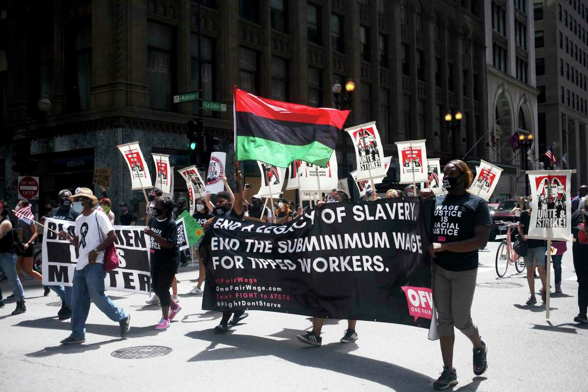 People march from the McDonald's restaurant on 180 W. Adams St. back to the James R. Thompson Center in Chicago on Monday, July 20, 2020. The event is a part of a nationwide strike that organizers hoped would involve tens of thousands of people walking off the job. Dubbed the
