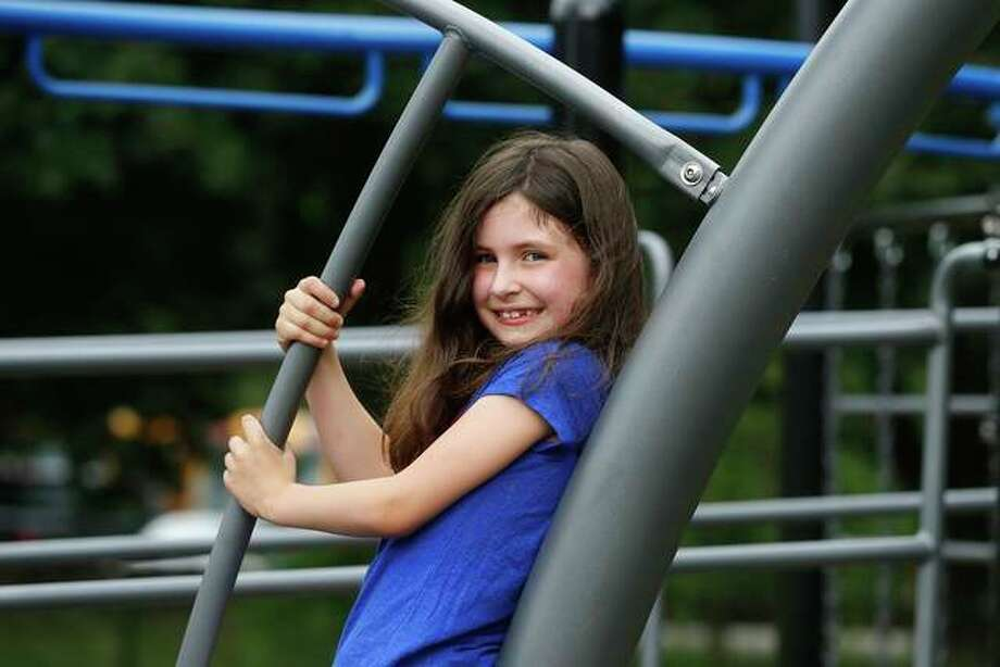 Sophia Garabedian, 6, who contracted Eastern equine encephalitis in 2019, plays this month near her home. As the coronavirus pandemic subsides for many states, public health officials are bracing for another mysterious virus — Eastern equine encephalitis, a rare but severe mosquito-borne virus. Photo: Steven Senne | AP