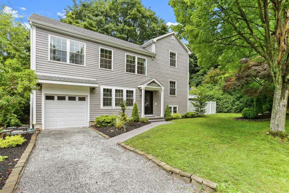 Listed for $1.075 million by Houlihan Lawrence, 3 Halock Drive is a four-bedroom colonial that's been renovated by its owner — a builder who lived here with his family. The asking price is $1.075 million. A public open house is planned for this Sunday, July 26, from 1 to 3 p.m. Photo: Contributed Photo