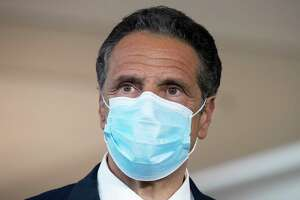 New York Gov. Andrew Cuomo wears a mask during a news conference at Laguardia Airport's Terminal B, in New York. New York is launching a national advertising campaign encouraging people to wear masks, said Cuomo, Thursday July 16, 2020, who has expressed concern about rising infections out-of-state.
