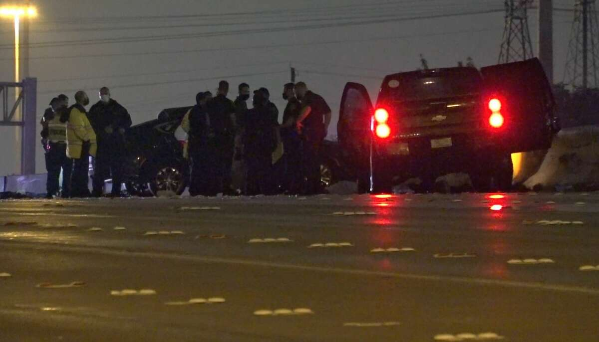 Houston police officers investigate a deadly wreck on U.S. 59 near Newcastle Drive on Tuesday, July 21, 2020.