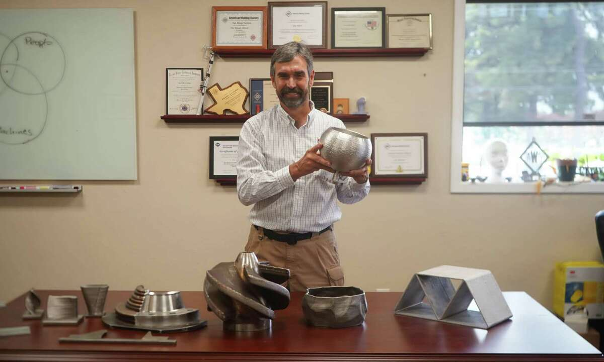 Dan Allford, CEO of ARC Specialties, shows parts made by his robots for different industries, including ship building. After the price of oil dropped due to COVID-19, Allford has started designing robots for other industries, including health care and space travel. He says diversification is important as the oil and gas industry shows little signs of recovery anytime soon.