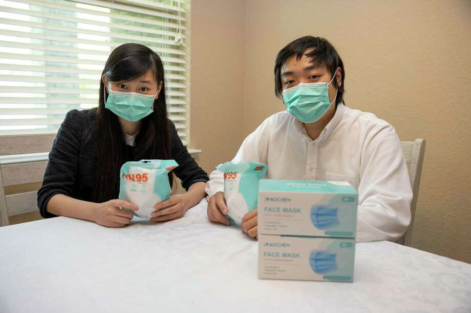 Jessica and Weimen Li, owners of Gnomedica, a company that distributes PPE, pose for a portrait in their home in The Woodlands, Thursday, July 16, 2020. Li donated over 10,000 masks to MD Anderson as a way to thank them for their work in caring for her late father. Photo: Gustavo Huerta, Houston Chronicle / Staff Photographer / Houston Chronicle © 2020
