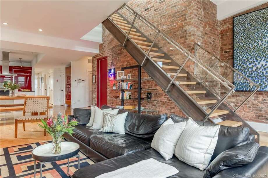 A modern loft-style condominium in the heart of New Haven is on the market for $725,000. The space is unit 5A at The Residences of 116 Crown Street, a historic building in the Ninth Square near the Wooster Square, Yale and tons of shops and restaurants. The building was built in 1912 and has been updated with modern amenities.  Photo: Collin Knapp / Tangibleplanet.com