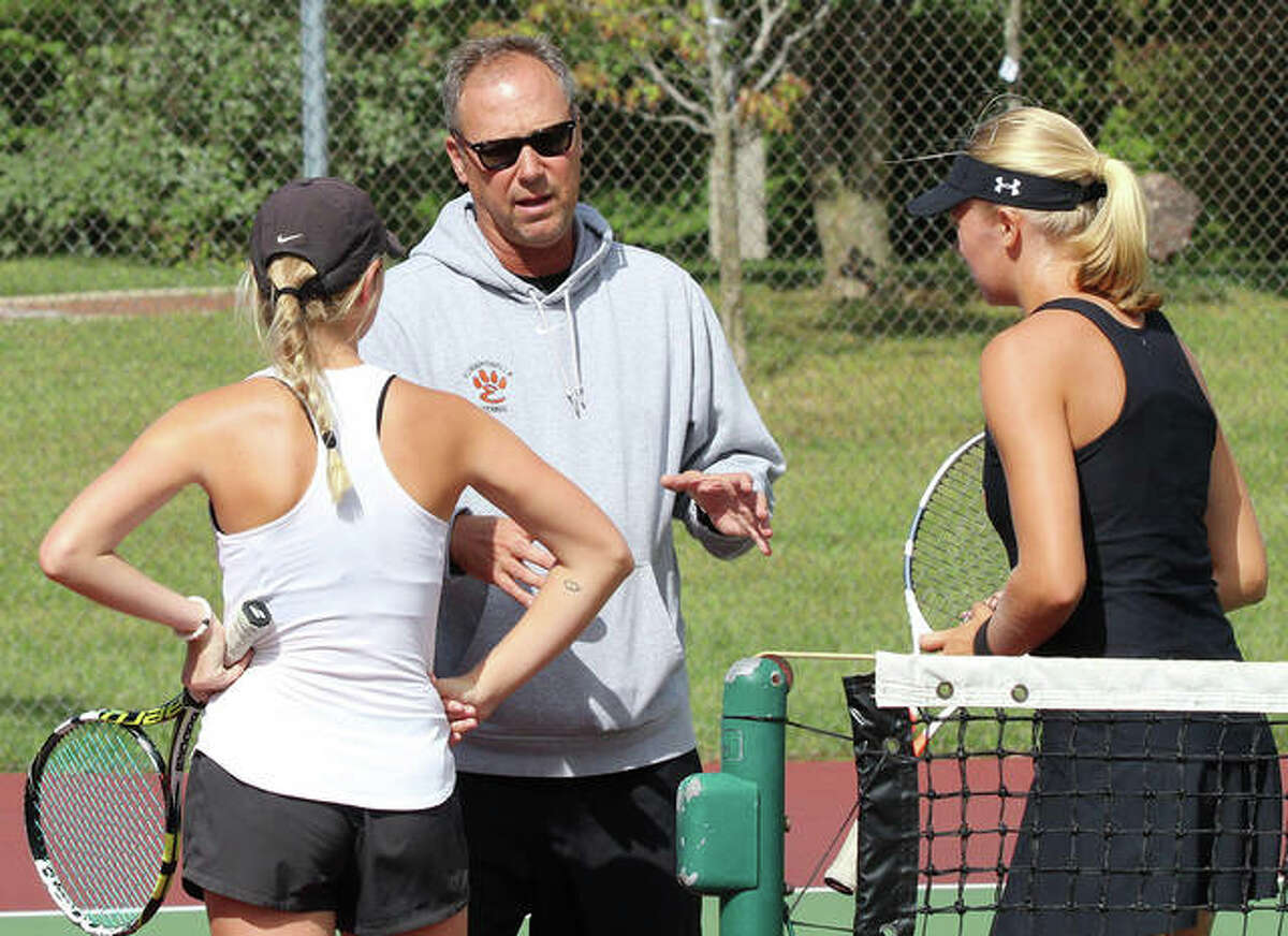 Edwardsville coach Dave Lipe (middle), shown talking to a Tigers doubles teams during a match in 2018, is the 2019 Telegraph Girls Tennis Coach of the Year.