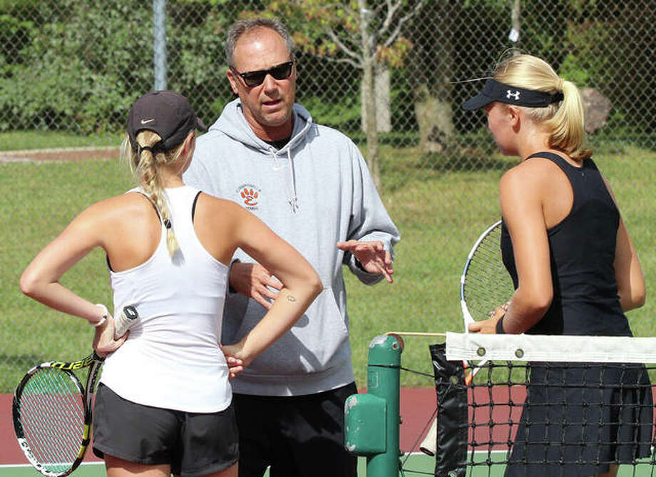 Edwardsville coach Dave Lipe (middle), shown talking to a Tigers doubles teams during a match in 2018, is the 2019 Telegraph Girls Tennis Coach of the Year. Photo: Greg Shashack / The Telegraph