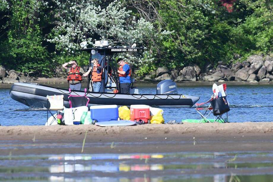 Dive team members from Haddam, Middletown and other surrounding towns look for a man who went missing Monday evening. Photo: Olivia Drake Photo