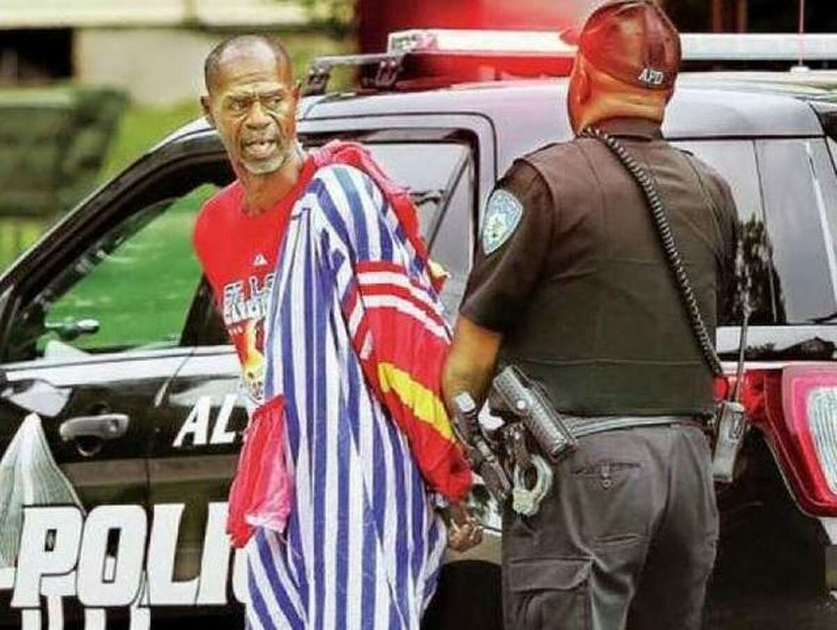 This 2018 file photo shows Ron Singleton dressed in a clown suit he allegedly burgled from an abandoned home and being arrested by an Alton police officer. For a second time, a judge has determined Singleton is not fit to stand trial, this time for allegedly trying to steal two lawn mowers in Alton in April.