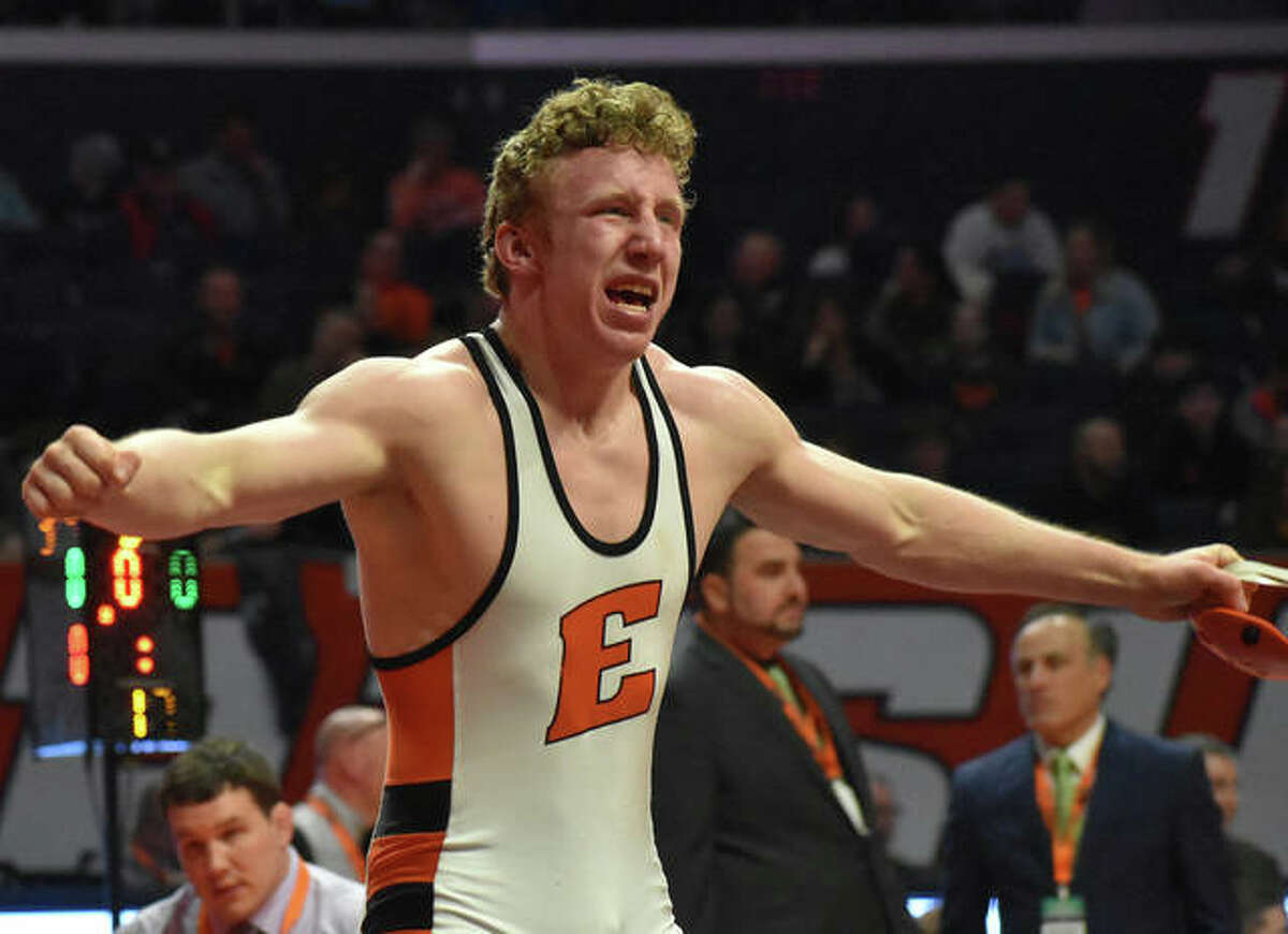 Edwardsville senior Luke Odom celebrates his state championship victory after defeating Bradley Gillum in the 160-pound match of the Class 3A final in February.