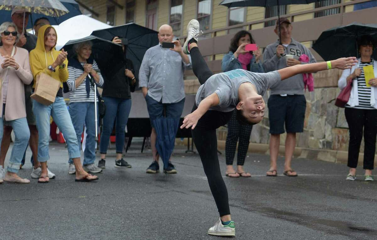 Connecticut Theater Dance dancer Lilliana Sperry, 12, performs during The 7th Annual Slice of Saugatuck Food Tasting and Retail Experience on Saturday September 8, 2018, in the Saugatuck neighborehood in Westport, Conn. After highly successful events starting in 2011 the Slice returns for the seventh year with over four dozen of Saugatuck's finest restaurants, shops and galleries opening their doors and inviting the community to come and sample their offerings.