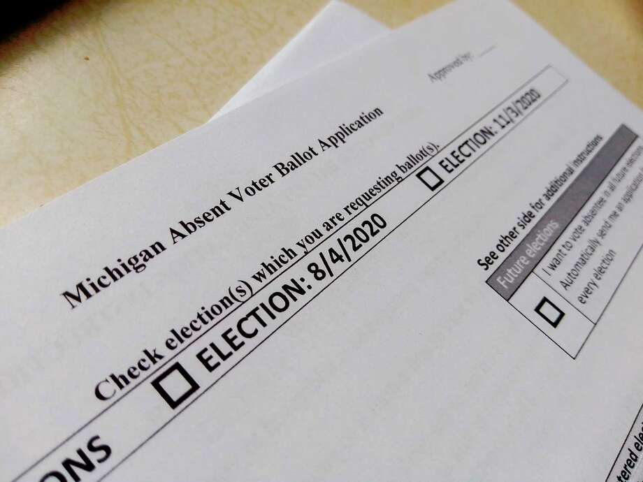 Grant Township Clerk Brenda Peterson is seeing more than double the township's typical absentee ballot requests this season as the state of Michigan mailed every registered voter an AV application because of concerns of the coronavirus. (Pioneer file photo) / Copyright,Spreadtrum,2011