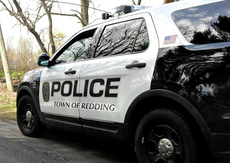 A Redding Police Officer sits in the driveway of the West Redding Fire Department as traffic goes by on Umpawaug Road. The Redding Police Department has increased its speed limit enforcement efforts on Umpawaug Road in preparation for a bridge project on Rt. 53 that could increase traffic on Umpawaug. Wednesday, April 6, 2016, in Redding, Conn. Photo: H John Voorhees III / Hearst Connecticut Media / The News-Times