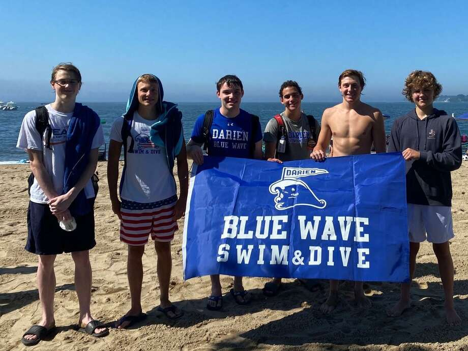 The Darien High School swimming program organized an open water event this past Saturday at Weed Beach in Darien to raise money for cancer. The money went to Swim Across America Fairfield. Photo: Contributed Photo