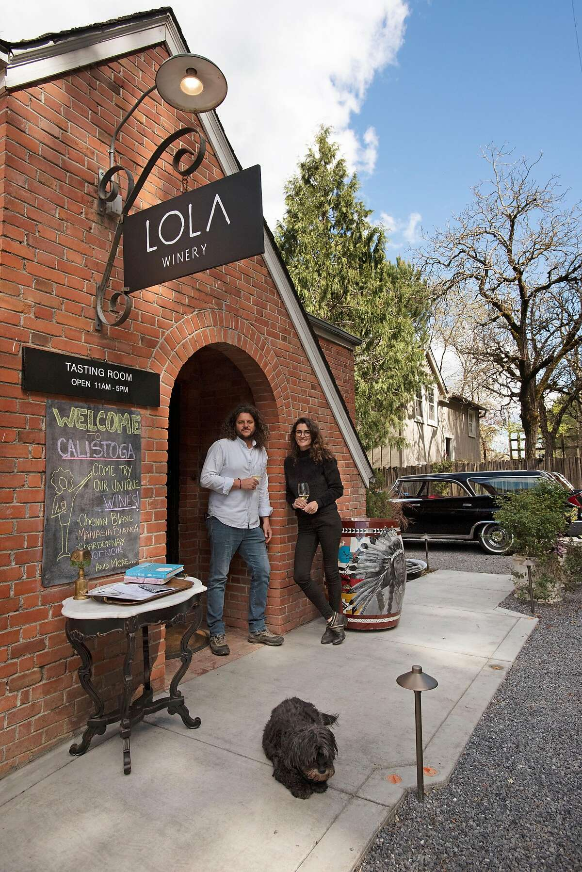 Seth Cripe and Rafaela Costa with their dog Lola at Lola Wines tasting room located in an 1890s building in Calistoga, California, on Thursday, March 19, 2020.